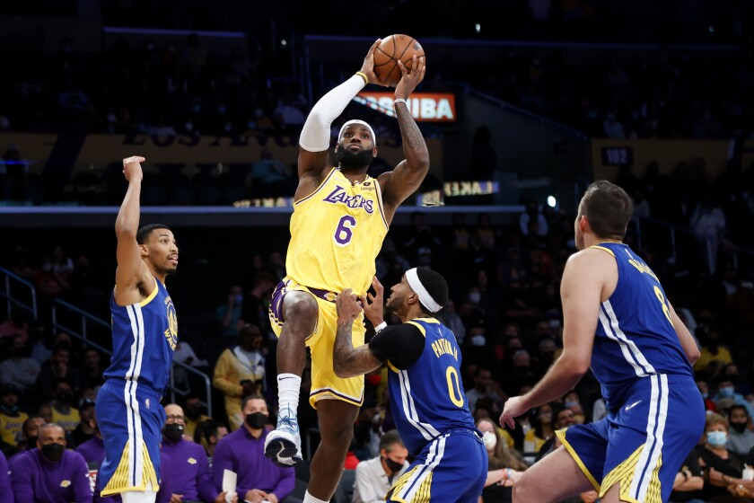 Lakers forward LeBron James shoots over Golden State Warriors guard Gary Payton II.