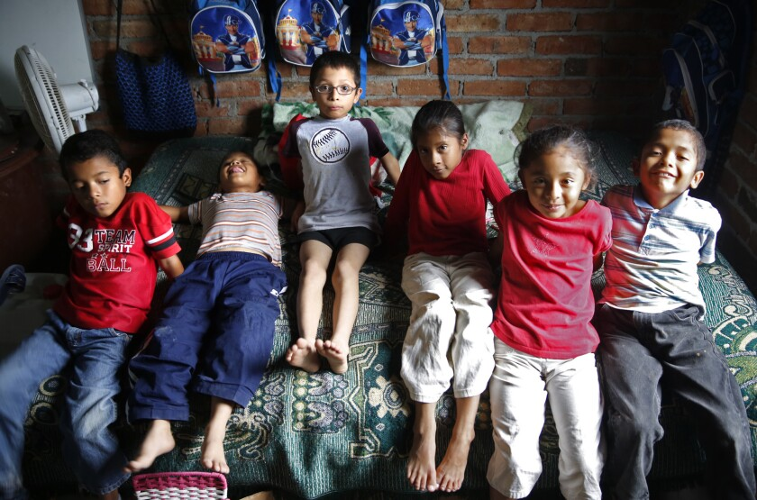 The 8-year-old Ireta sextuplets -- Noe, Carlos, Omar, Maria, Teresa, and Marcos -- in their home near Irapuato, Mexico. They were born in San Diego to undocumented Mexican parents Benigno and Gabriela Ireta.