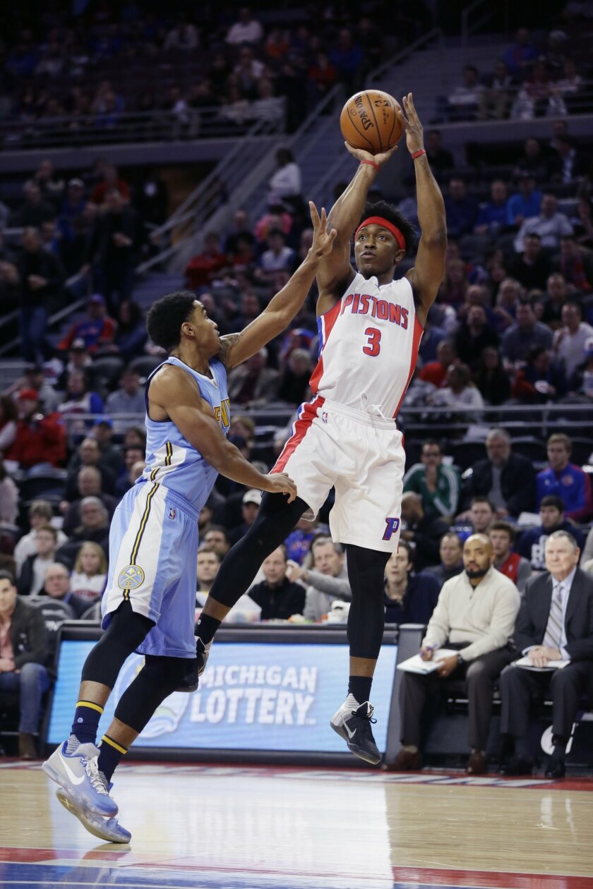 Detroit Pistons forward Stanley Johnson (3) shoots over Denver Nuggets guard Gary Harris during the first half of an NBA basketball game, Wednesday, Feb. 10, 2016 in Auburn Hills, Mich. (AP Photo/Carlos Osorio)