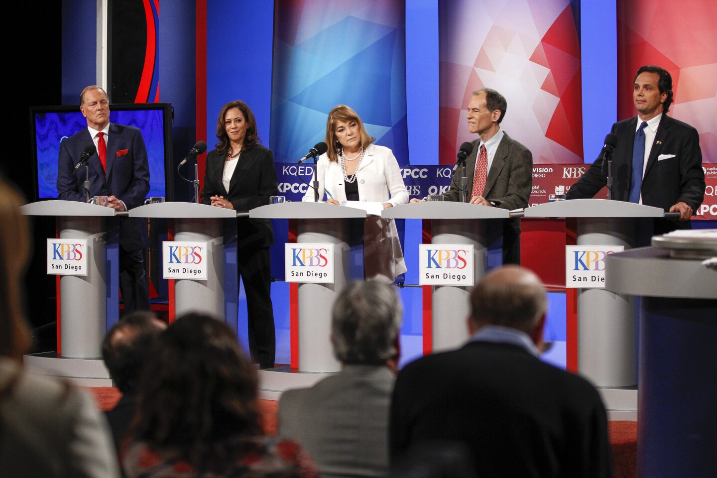 "The top five candidates running to replace retiring Sen. Barbara Boxer, from left, George ""Duf"" Sundheim, Kamala Harris, Loretta Sanchez, Ron Unz and Tom Del Beccaro, stand on stage as they debate in San Diego on May 10."