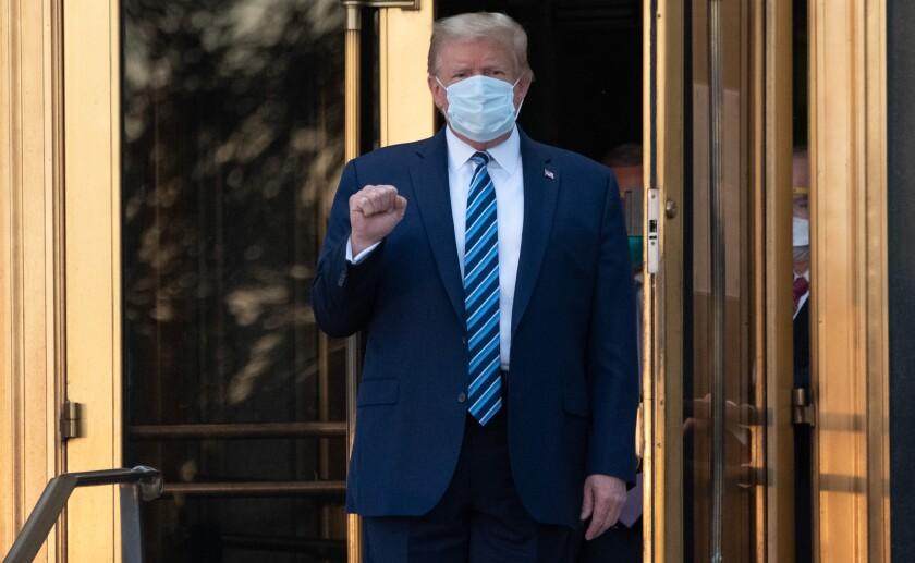 President Trump gestures as he walks out of Walter Reed National Military Medical Center in Bethesda, Md., on Oct. 5.