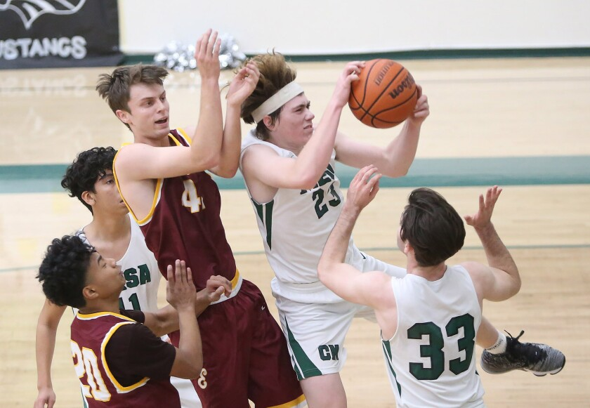 Costa Mesa's Blake Wolf (23), shown competing against Estancia in January 2020, had 22 points in the Mustangs' 93-60 win.