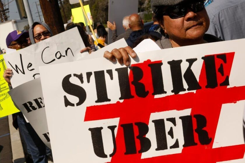 Ride-share drivers picket as part of a 25-hour strike in May in Redondo Beach