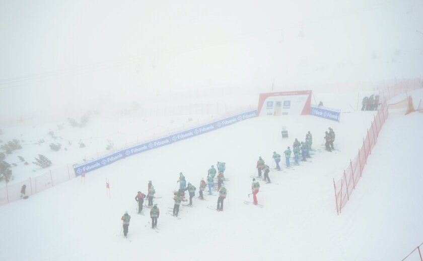 The race course of an alpine ski, women's World Cup super-G event is engulfed in fog, in Bansko, Bulgaria, Friday, Feb. 27, 2015. The race has been canceled. (AP Photo/Pier Marco Tacca)