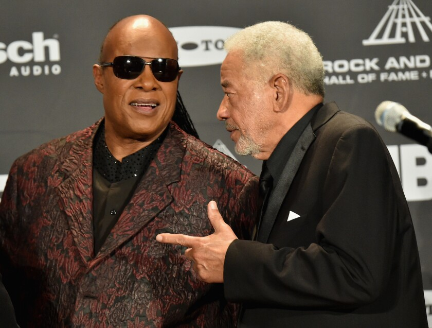Stevie Wonder, left, and Bill Withers at the 2015 Rock & Roll Hall of Fame induction ceremony, where Withers was among the inductees. — Photograph: Michael Loccisano/Getty Images.