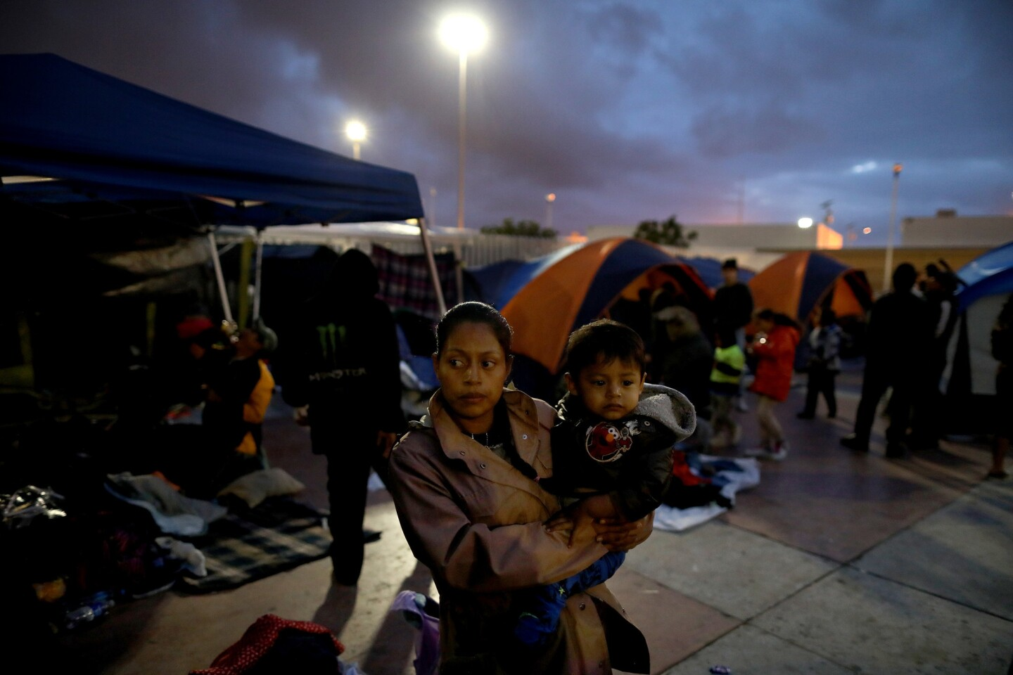 Night falls on a camp where nearly 200 Central American migrants seeking asylum in the U.S. gather on their third day near the El Chaparral port of entry in Tijuana.