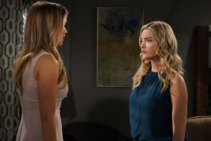 "In this March 8, 2019 photo released by CBS, Katrina Bowden, left, and Denise Richards appear in a scene from the daytime series ""The Bold and the Beautiful."" Richards returns to work on the CBS soap opera after production had been shut down for three months due to the outbreak of COVID-19. The series is one of the first U.S. productions to resume filming. (Cliff Lipson/CBS via AP)"