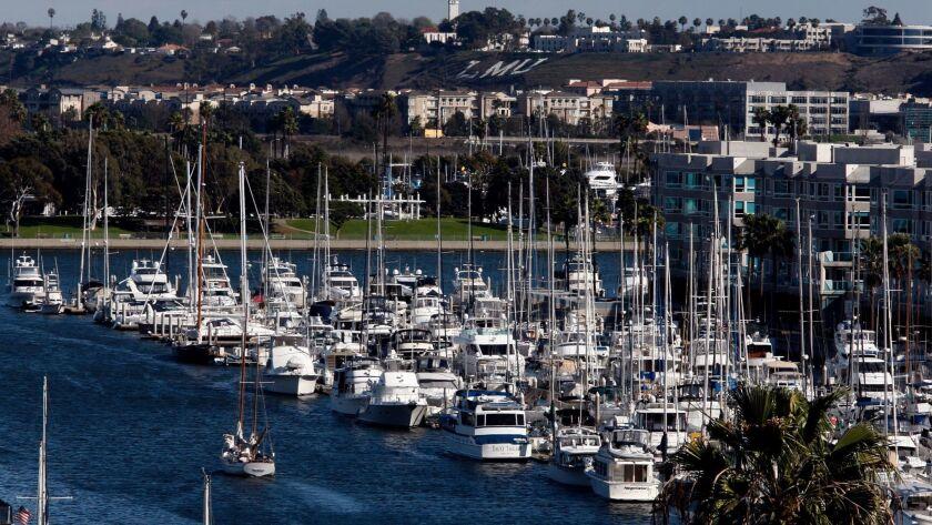 LOS ANGELES, CA-FEB. 2, 2014: A sailboat motors through Marina del Rey Harbor, which is home to mor