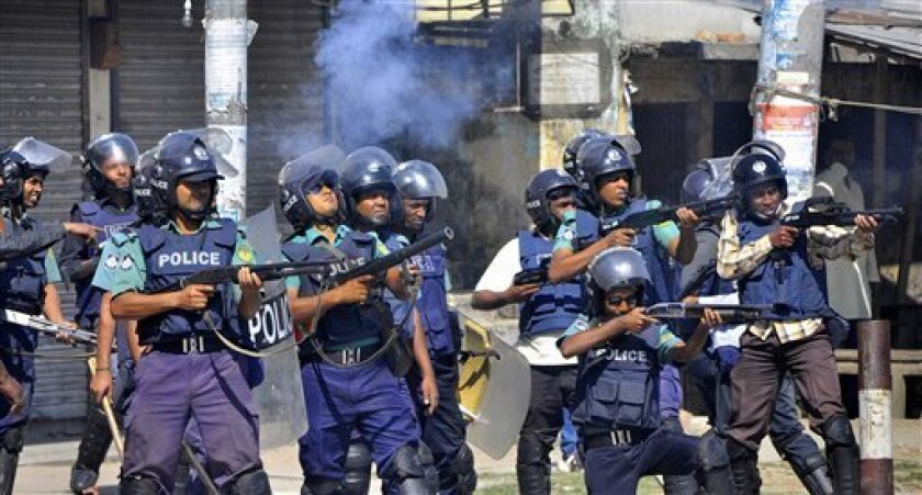 Bangladeshi policemen disperse protesters in Rajshahi, Bangladesh, Friday, March 1, 2013. Protesters clashed with police for a second day Friday as the death toll rose to at least 44 in clashes triggered by a death sentence given to Delwar Hossain Sayedee, one of the top leaders of the country's la