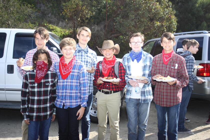 Michael Khamishon, Sam Grudko, Bridger Dunkley, Will MacDonald, Koji Sakamoto, Alexander Myers and Walter Birnbaum attend Muirlands Middle School's Western BBQ on Dec. 20, 2018.