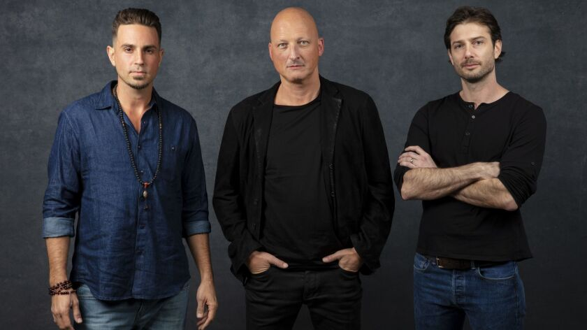 "Wade Robson, left, director Dan Reed and James Safechuck from the documentary ""Leaving Neverland,"" which is prompting outrage from Michael Jackson devotees."
