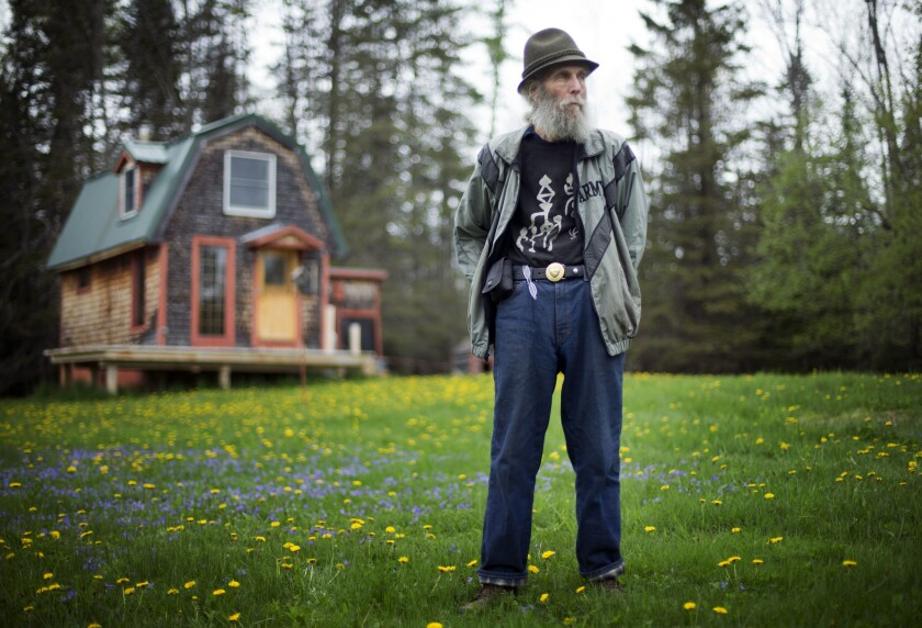 Burt Shavitz, co-founder of Burt's Bees, poses on his property in Parkman, Maine, on May 23, 2014. The converted turkey coop in the background that Shavitz once called home is going to be saved and displayed at the company's headquarters in North Carolina.