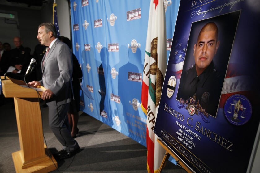 LAPD Chief Charlie Beck announces the murder charge against the man accused of ramming his SUV into Officer Roberto Sanchez's patrol car.