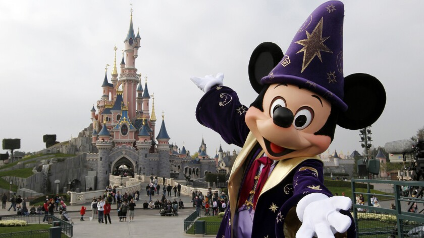 Mickey posing in front of the Sleeping Beauty Castle at Disneyland park, in Chessy, near Marne-la-Vallee, outside Paris.