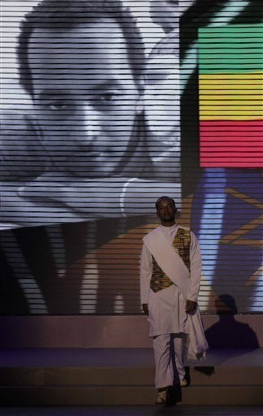 Ethiopia's Robel Hailu takes part in the grand finale of the Mr. Gay World 2012 competition in Johannesburg, Sunday, April 8, 2012. After Hailu entered the contest, his father cut off all communications with him. (AP Photo/Denis Farrell)