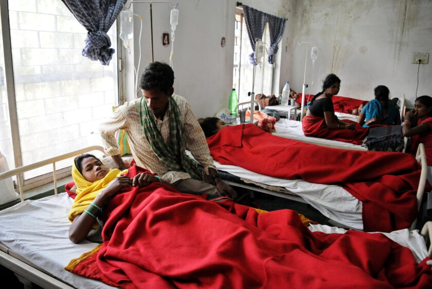 Indian women who underwent sterilization surgeries receive treatment Nov. 12 at the District Hospital in Bilaspur in the central Indian state of Chhattisgarh after at least a dozen others died following similar surgery.