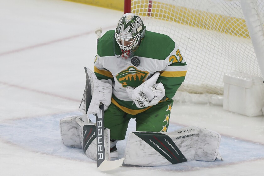 Minnesota Wild goalie Cam Talbot stops the puck during the first period of the team's NHL hockey game against the Arizona Coyotes, Friday, March 12, 2021, in St. Paul, Minn. (AP Photo/Stacy Bengs)