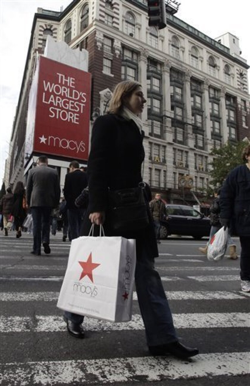 A woman carries a Macy's shopping bag, Wednesday, Nov. 10, 2010 in New York. Department store operator Macy's Inc. said Wednesday that it turned a profit in the third quarter, compared with a loss a year ago, boosted by tailoring merchandise to local markets. And it brightened its predictions for the year. (AP Photo/Mark Lennihan)