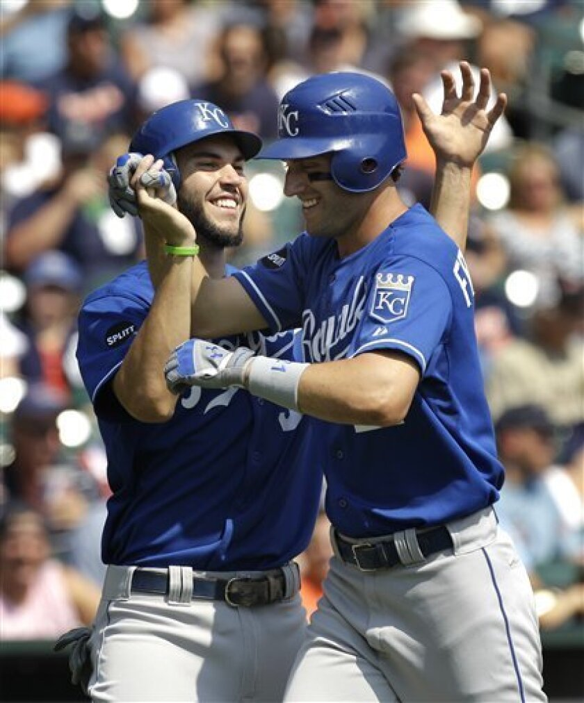 Kansas City Royals' Jeff Francoeur, right, is congratulated by Eric Hosmer, left, after hitting a two-run home run against the Detroit Tigers in the second inning of a baseball game in Detroit, Thursday, Sept. 1, 2011. (AP Photo/Paul Sancya)