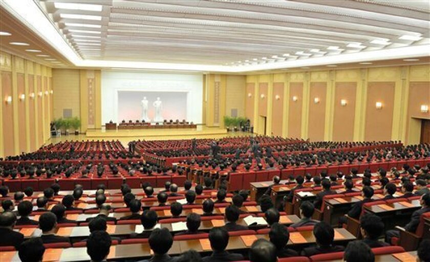 "In this April 11, 2012 photo released Thursday, April 12, 2012 by Korean Central News Agency via Korea News Service, North Korea's young leader Kim Jong Un, center in the background, attends a conference of the ruling Worker's Party in Pyongyang, North Korea. Kim was named first secretary of the party, a newly created post, while his father, late longtime leader Kim Jong Il was granted the posthumous title of ""eternal general secretary"" at the special one-day party conference Wednesday. (AP Photo/Korean Central News Agency via Korea News Service) JAPAN OUT UNTIL 14 DAYS AFTER THE DAY OF TRANSMISSION"