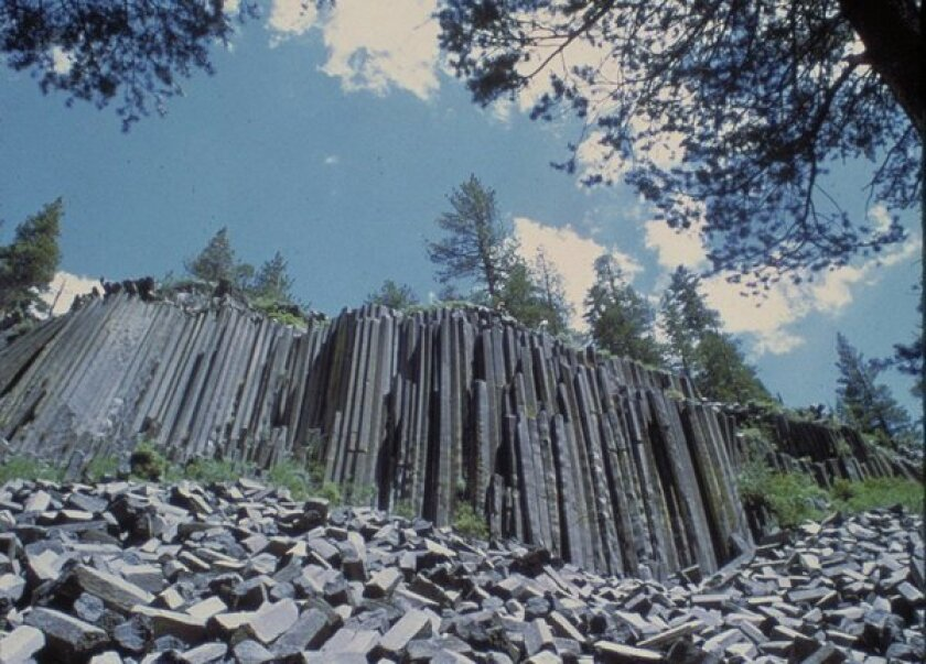 Volcanic activity created the columnar basalt of Devils Postpile near Mammoth Mountain.