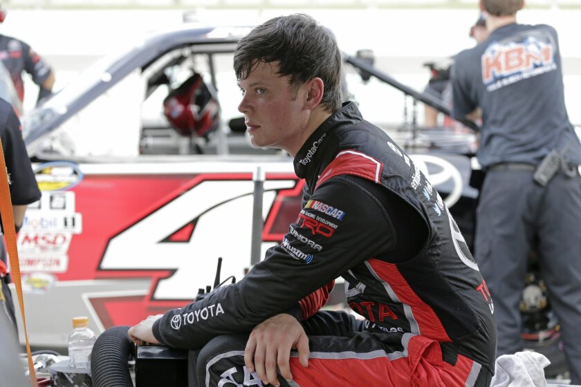 Eric Jones (4) sits on pit wall after taking some practice laps during final practice for the NASCAR Camping World Truck Series auto race, Friday, Nov. 20, 2015, at Homestead-Miami Speedway in Homestead, Fla. (AP Photo/Terry Renna)