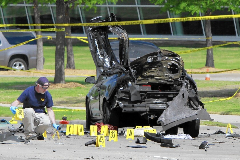 An FBI investigator in Garland, Texas, where two men opened fire outside a Muhammad cartoon contest.