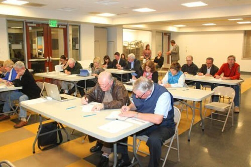 Workshop attendees complete a questionnaire prioritizing the importance of funding various city-owned and -maintained infrastructure assets.