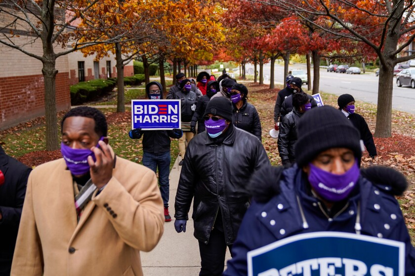 Parishioners walk from Greater Grace Temple toward the Five Points neighborhood in Detroit on Sunday.