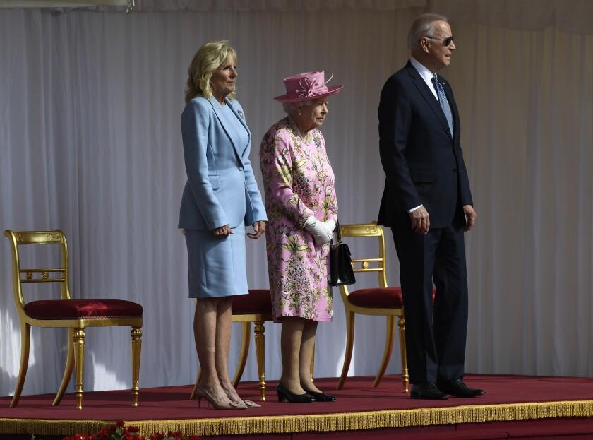 Britain's Queen Elizabeth II stands with President Biden and First Lady Jill Biden at Windsor Castle.