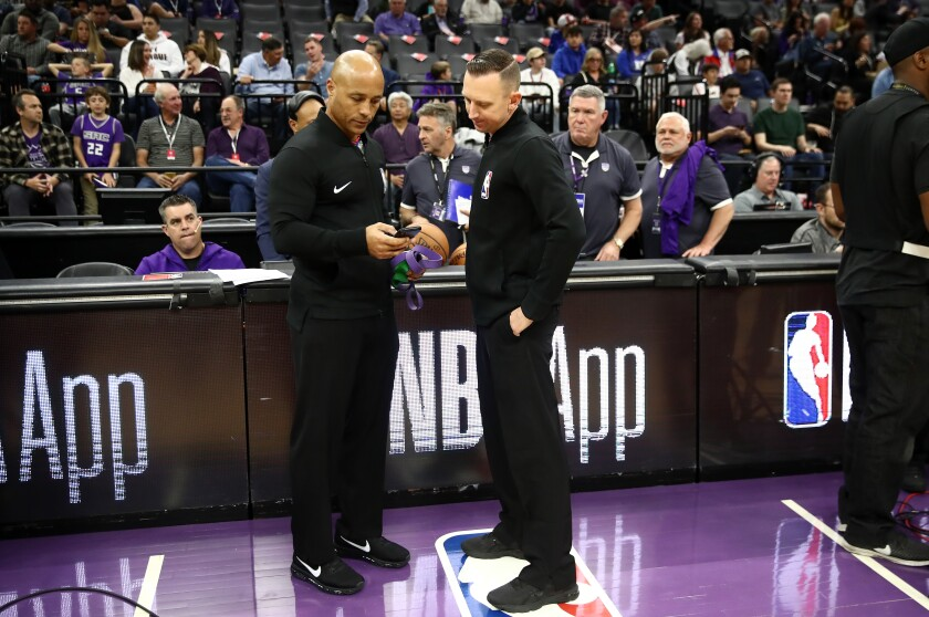 Referees Marc Davis, Justin Van Duyne at the Kings-Pelicans game, which was postponed.