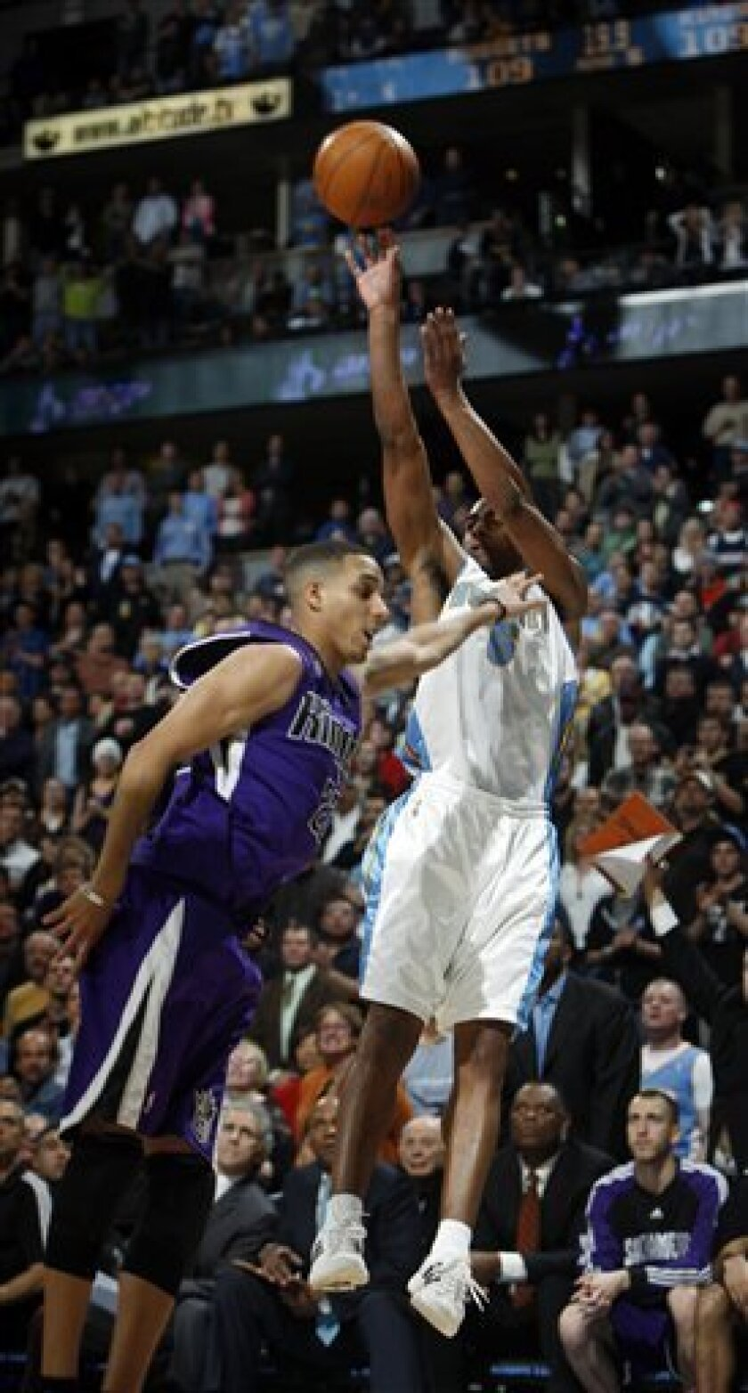 Denver Nuggets guard Arron Afflalo, back, shoots the go-ahead basket with just under 20 seconds remaining in the overtime session over Sacramento Kings guard Kevin Martin in the Nuggets' 112-109 overtime victory in an NBA basketball game in Denver on Monday, Feb. 1, 2010. (AP Photo/David Zalubowski)