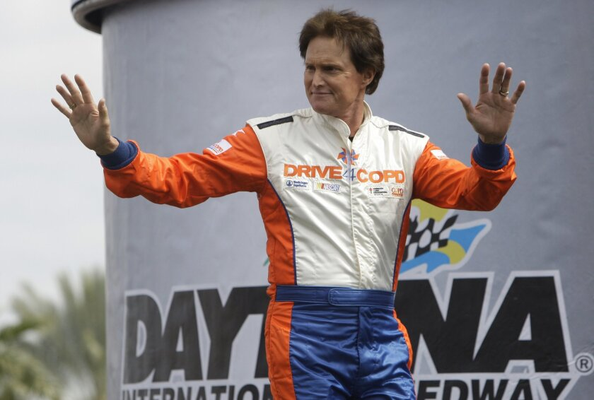 FILE - In this Feb. 13, 2010 file photo, former Olympian Bruce Jenner waves to race fans before the start of the DRIVE4COPD 300 Nationwide auto race at Daytona International Speedway in Daytona Beach, Fla. With speculation flying, Bruce Jenner's mother opened up Wednesday, Feb. 4, 2015, about his gender journey. Esther Jenner, 88, has been besieged by calls from the media in recent days, but the widow in Lewiston, Idaho, isn't interested in fueling gossip. Instead, in a wide-ranging, nearly hour-long phone interview, she praised her Olympian son for his courage, stopping short of some details that have been floated by unnamed sources online and in tabloids. (AP Photo/John Raoux, File)