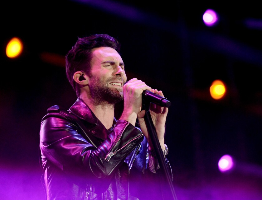 """Adam Levine, shown performing with Maroon 5 at KIIS FM's Wango Tango earlier this month, offended many viewers by muttering """"I hate this country"""" Tuesday night on NBC-TV's """"The Voice."""""""