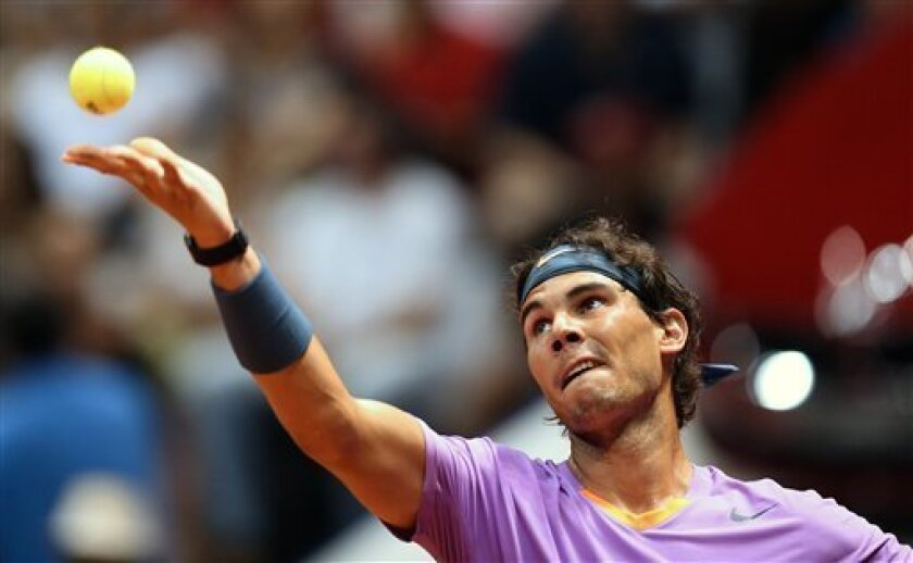 Spain's Rafael Nadal prepares to serve to Argentina's Martin Alund during a Brazil Open ATP tournament semifinal tennis match in Sao Paulo, Brazil, Saturday, Feb. 16, 2013. (AP Photo/Andre Penner)