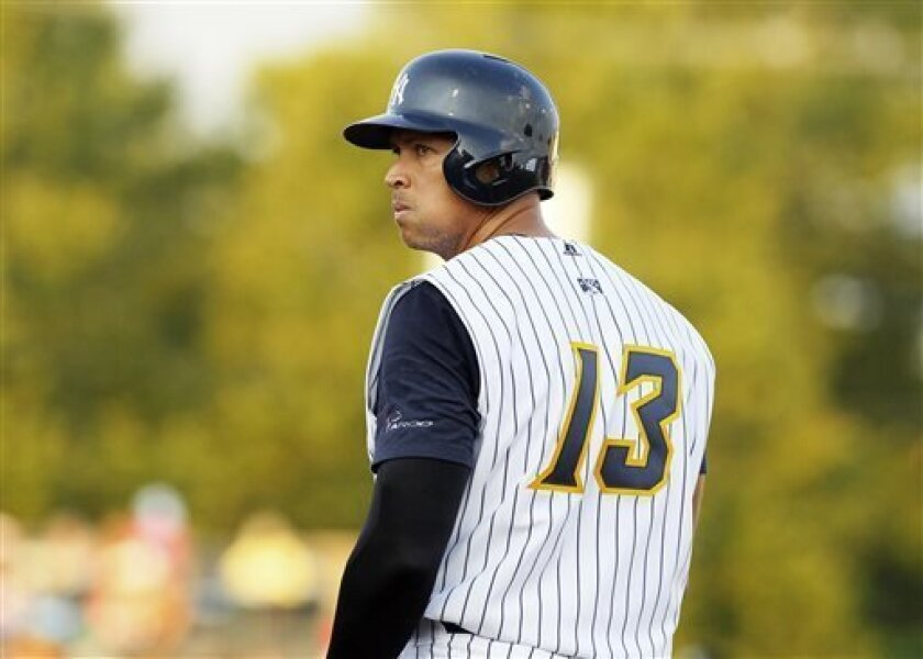 New York Yankees' Alex Rodriguez looks back while standing on first base after being walked during a Class AA baseball game with the Trenton Thunder against the Reading Phillies, Friday, Aug. 2, 2013, in Trenton, N.J. (AP Photo/Tom Mihalek)