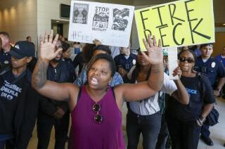 Angry protesters at LAPD press conference on officer-involved shooting
