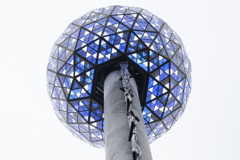 The New Year's Eve ball is prepared for its big moment in New York's Times Square. The 11,875-pound geodesic sphere, covered by 2,688 Waterford Crystal triangles, will descend a 130-foot pole to mark the stroke of midnight.
