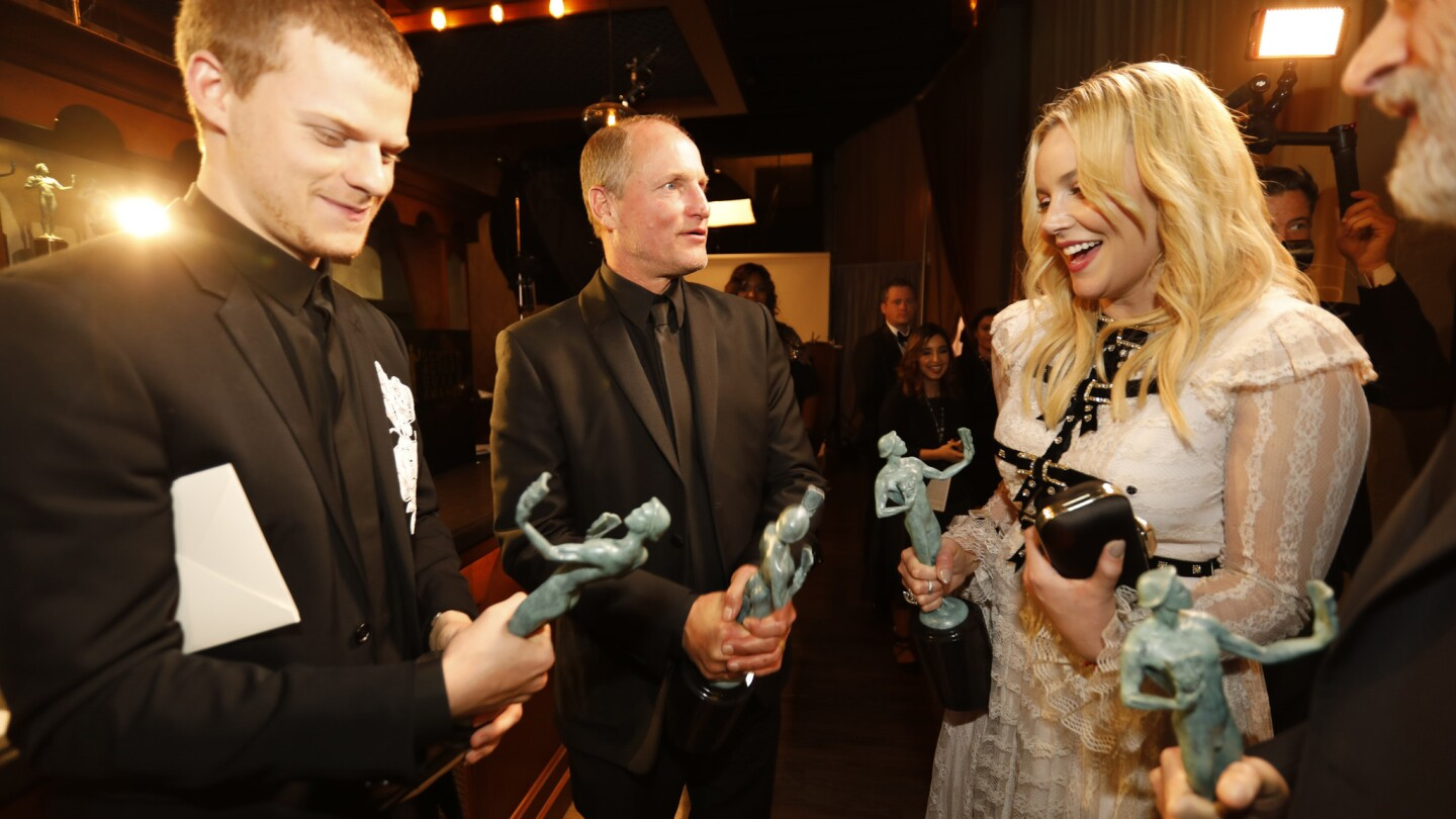 """Lucas Hedges, left, Woody Harrelson, Abbie Cornish and John Hawkes backstage with their Actors after winning outstanding performance by a cast in a motion picture, """"Three Billboards Outside Ebbing, Missouri"""" at the 24th Screen Actors Guild Awards at the Los Angeles Shrine Auditorium and Expo Hall on Jan. 21, 2018."""