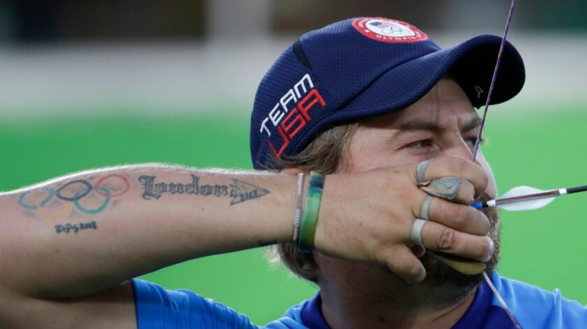 Brady Ellison of the United States releases an arrow during the men's team archery competition at the 2016 Summer Olympics on Aug. 6.
