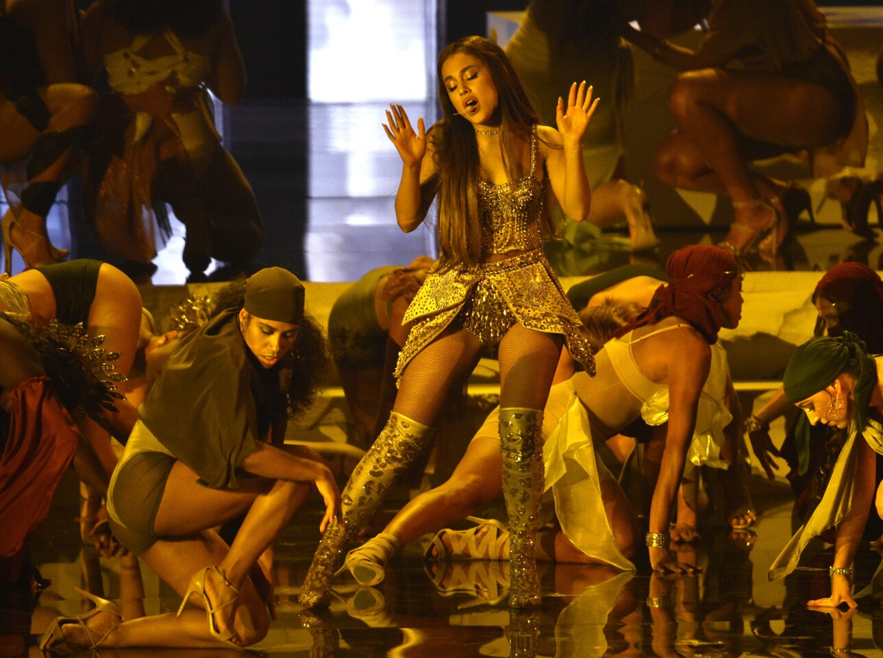 "Ariana Grande, center, performs ""God is a woman"" at the MTV Video Music Awards."