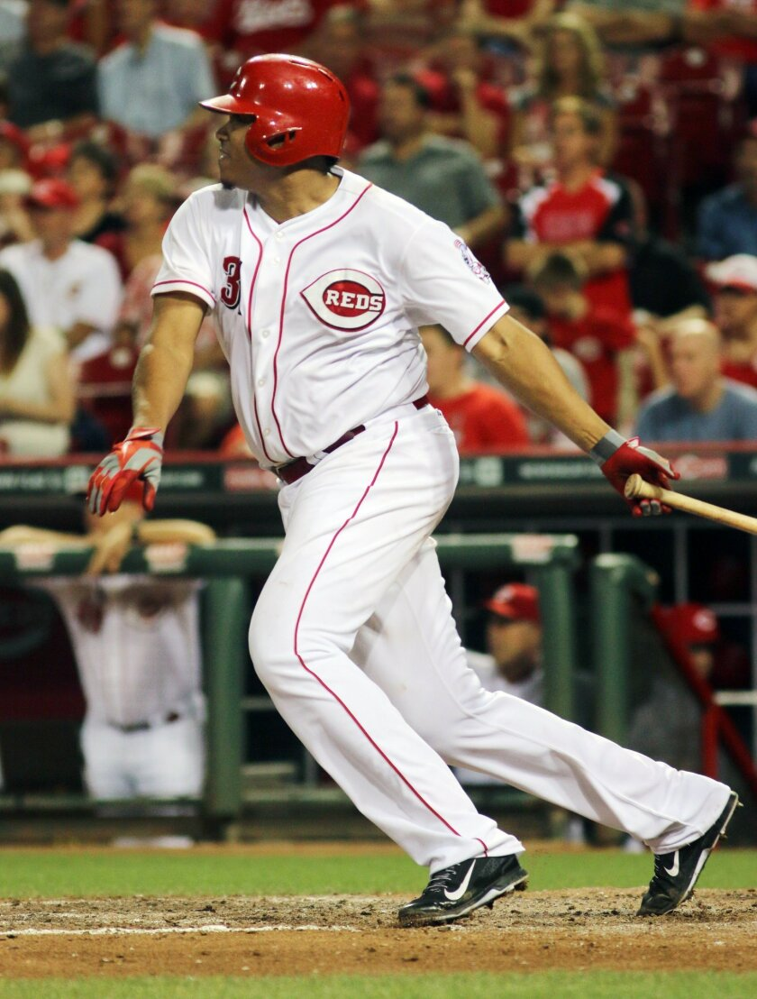 Cincinnati Reds pitcher Alfredo Simon hits an RBI double in the forth inning of their baseball game against the St. Louis Cardinals in Cincinnati, Wednesday Sept. 10, 2014. (AP Photo/Tom Uhlman)