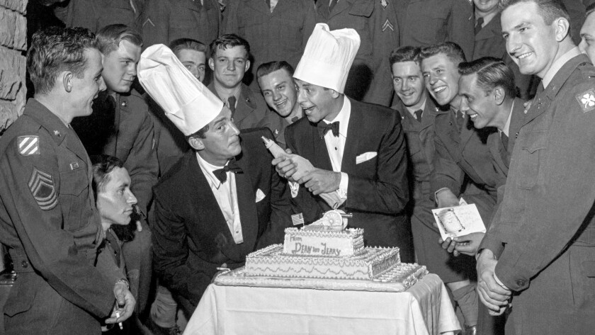 Dean Martin (left with chef's hat) and Jerry Lewis clown around while entertaining troops at the Las