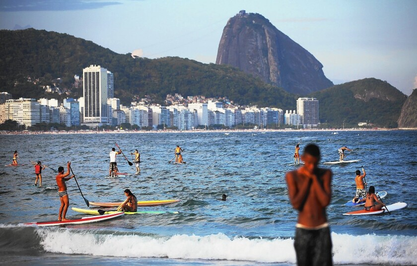 People in Rio de Janeiro have been griping about the rising costs of restaurant food, taxi rides, color copies, liquor, produce and more. Above, Copacabana Beach.