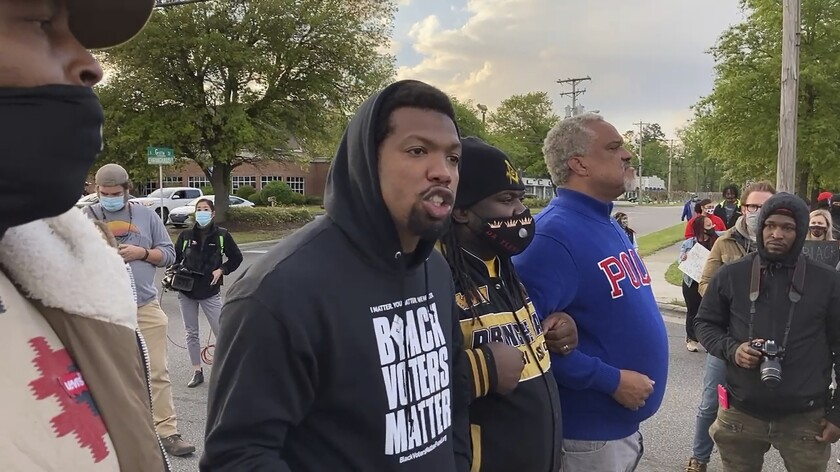 Quentin Jackson, regional director for the National Black Caucus of Local Elected Officials, addresses protesters.