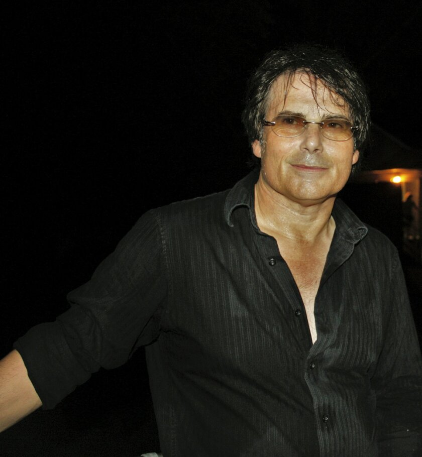"This undated photo provided by Sally J. Irwin shows Jimi Jamison in Chicago. Jamison, who sang lead on Survivor hits such as ""Burning Heart"" and ""Is This Love,"" has died. He was 63. (AP Photo/Sally J. Irwin)"