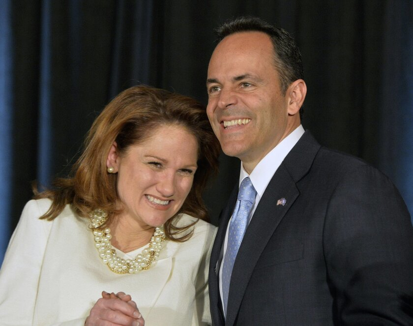 Kentucky Republican Gov.-elect Matt Bevin, right, and his wife Glenna react to the cheers of supporters during his introduction at the Republican Party victory celebration, Tuesday, Nov. 3, 2015, in Louisville, Ky. Bevin has defeated Democrat Jack Conway to become only the second Republican governo