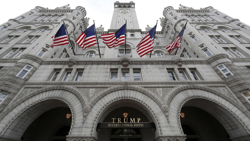 FILE - This Dec. 21, 2016, file photo, shows the arched facade of The Trump International Hotel at 1
