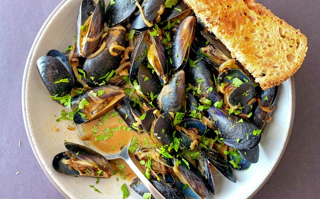 Miso and charred shallots add flavor and body to a rosé wine broth for steaming mussels in this dinner for one.