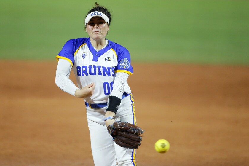 UCLA's Rachel Garcia pitches to a Florida State batter during an NCAA Women's College World Series softball game in Oklahoma City, Thursday, June 3, 2021. (Bryan Terry/The Oklahoman via AP)